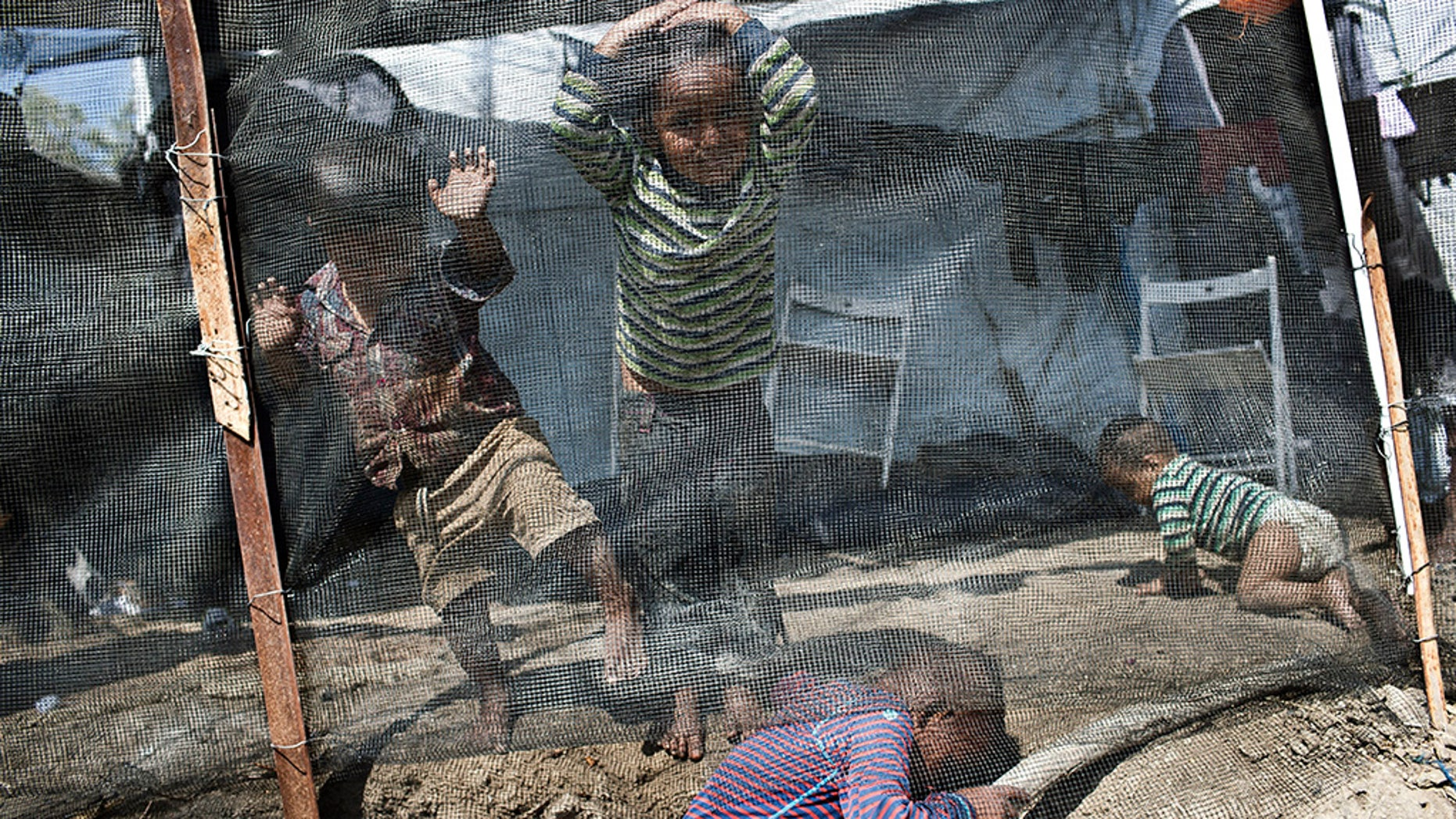 Children play inside the Moria refugee camp on the northeastern Aegean island of Lesbos, Greece. The jammed camp serves as a sober reminder to European leaders that their statistical success in curbing migration into the continent has spawned what the U.N. and others condemn as massive humanitarian failures.