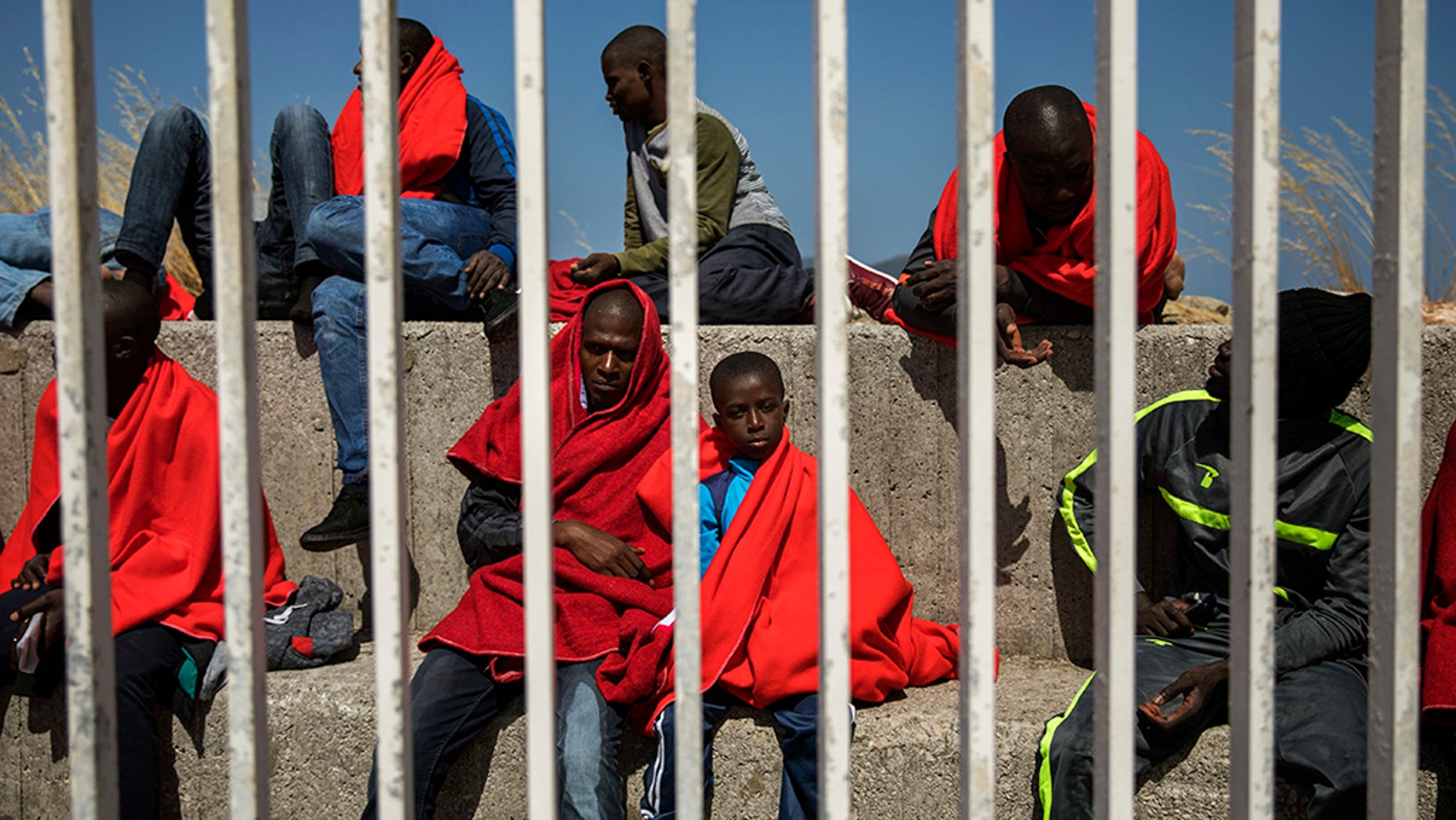 Migrants resting at the port of Algeciras, southern Spain, as they waited to be transported to a police station after being rescued in the Strait of Gibraltar on Tuesday.