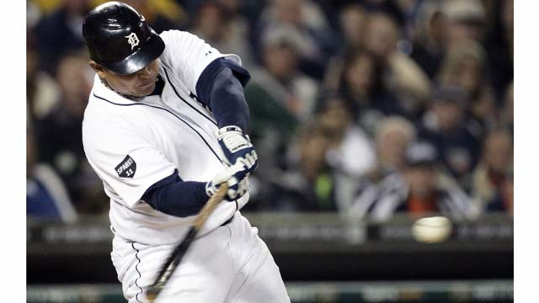 Detroit Tigers' Miguel Cabrera hits a solo home run against the Cleveland Indians in the sixth inning of a baseball game Tuesday, Sept. 27, 2011 in Detroit. (AP Photo/Duane Burleson)