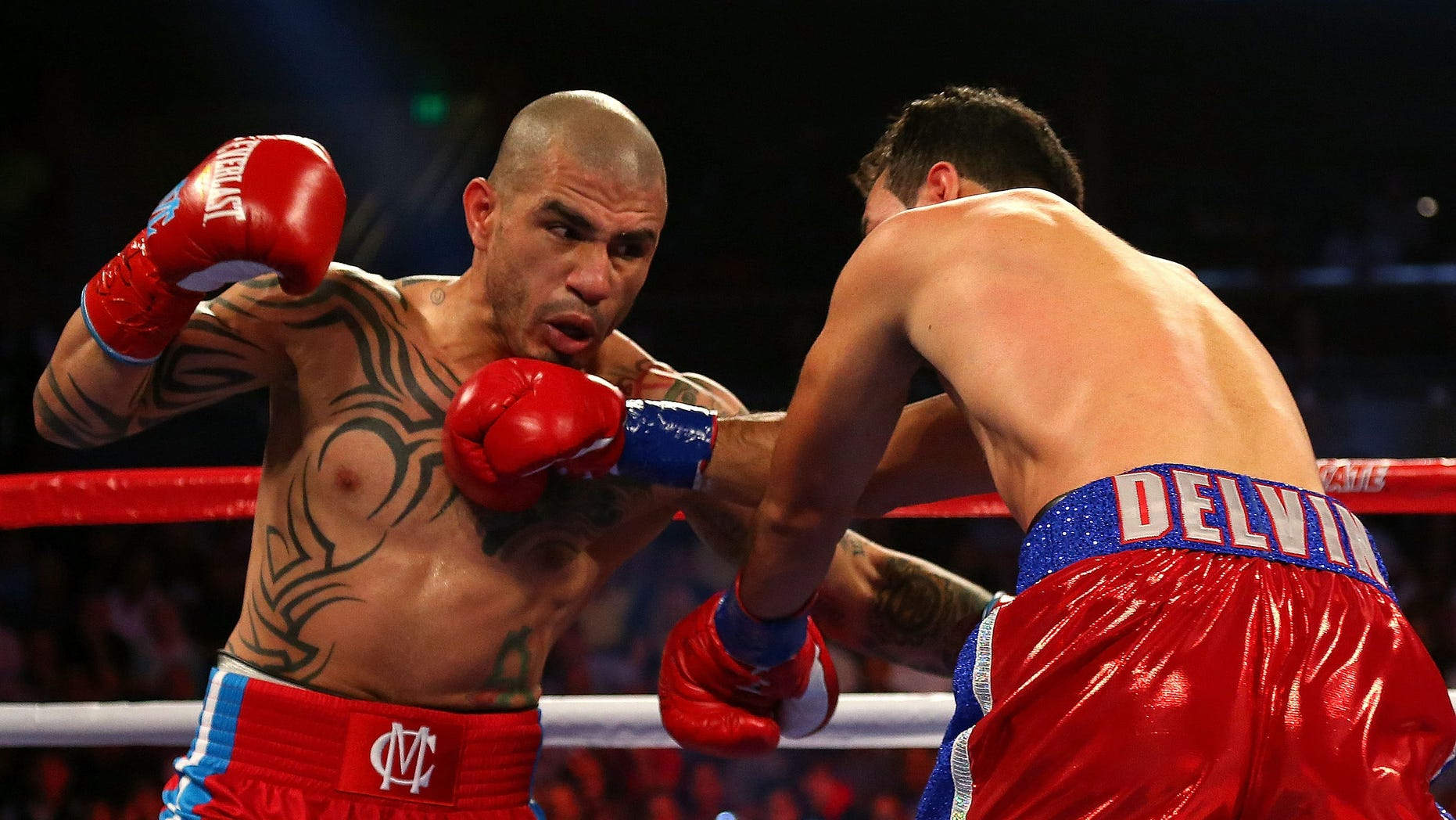 ORLANDO, FL - OCTOBER 05:  Miguel Cotto throws a punch against Delvin Rodriguez during a Super Welterweight bout at Amway Center on October 5, 2013 in Orlando, Florida.  (Photo by Mike Ehrmann/Getty Images)