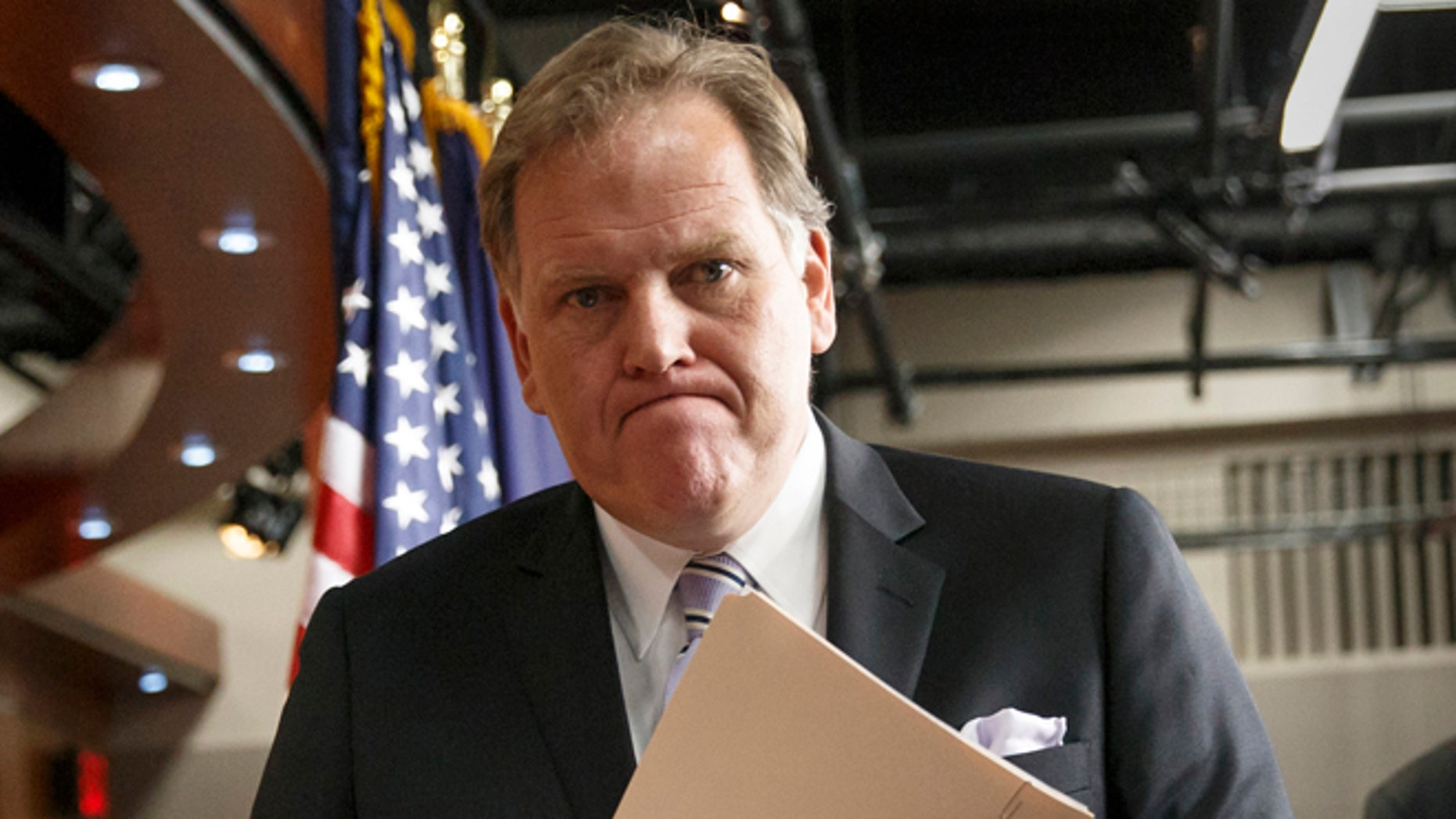 This March 25, 2014 file photo shows House Intelligence Committee Chairman Mike Rogers, R-Mich., leaving a press conference on Capitol Hill in Washington.