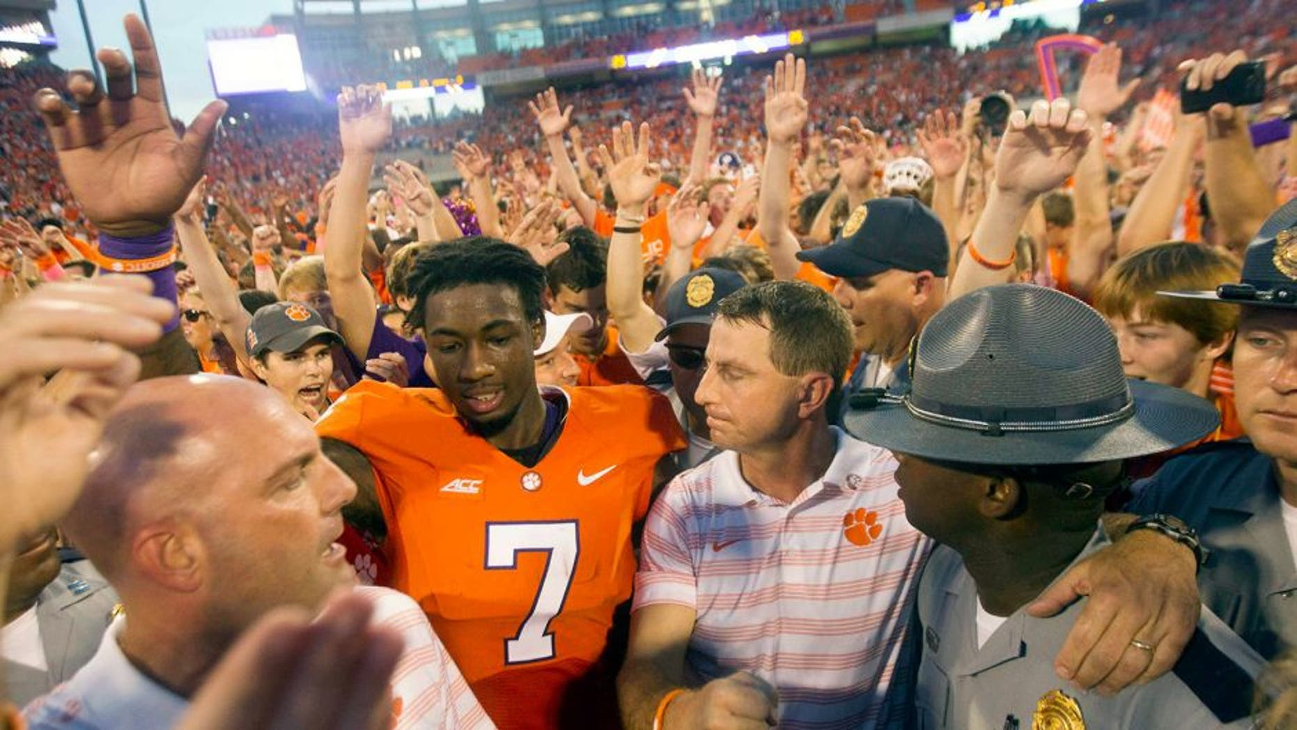 Oct 11, 2014; Clemson, SC, USA; Clemson Tigers wide receiver Mike Williams (7) celebrates with head coach Dabo Swinney (center right) after the game against the Louisville Cardinals at Clemson Memorial Stadium. Tigers won 23-17. Mandatory Credit: Joshua S. Kelly-USA TODAY Sports