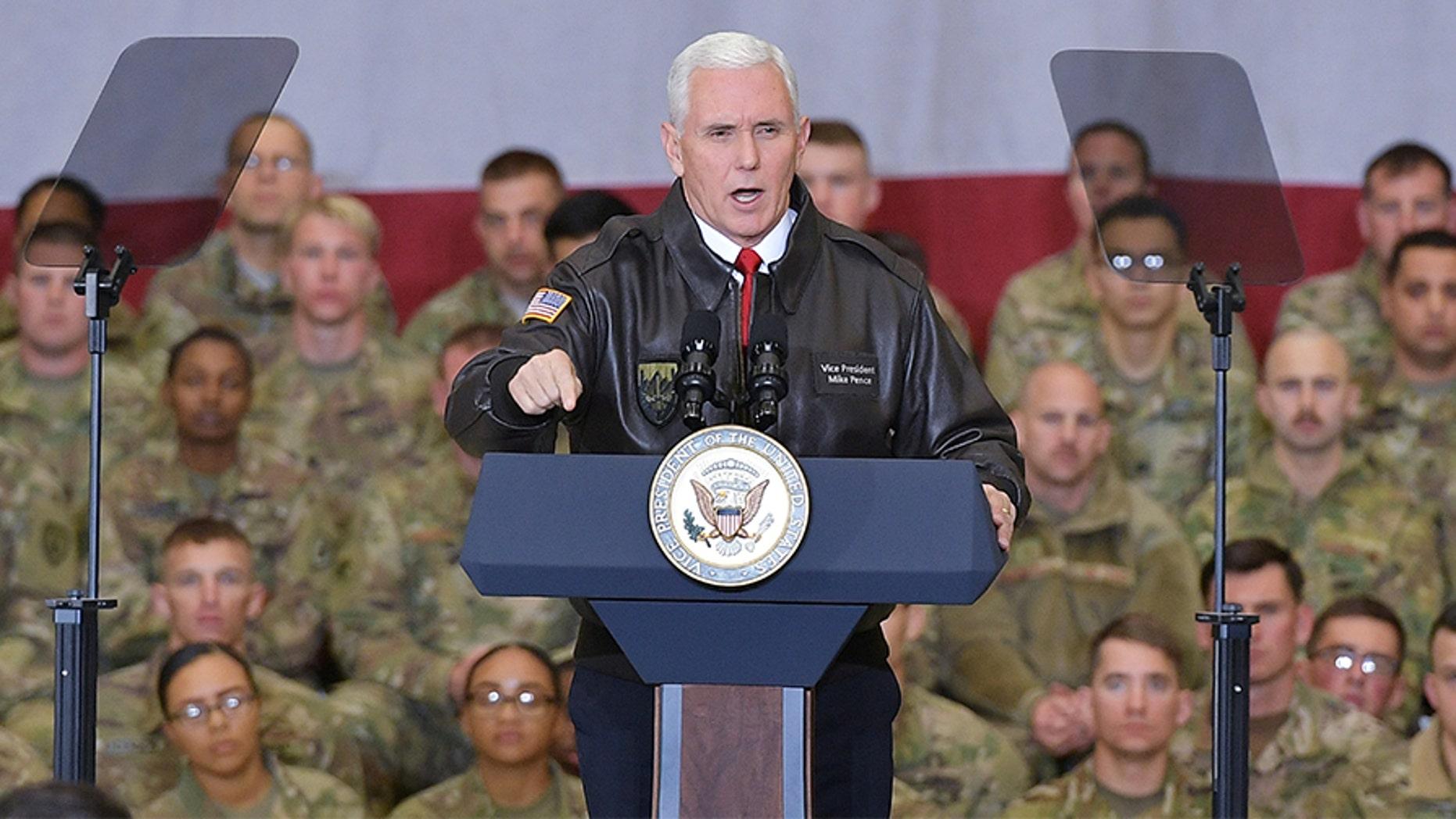 U.S. Vice President Mike Pence speaks to troops in a hangar at Bagram Air Field in Afghanistan on December 21, 2017.