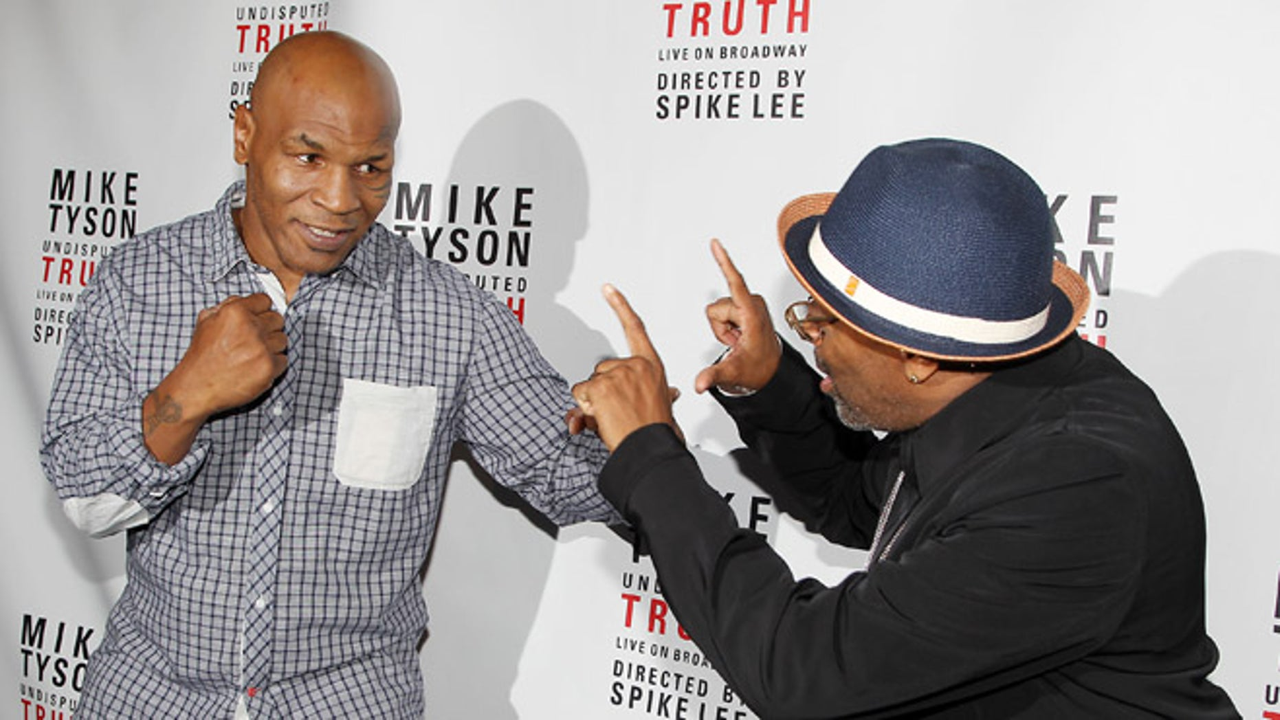 Aug. 2: Mike Tyson, left, and Spike Lee pose backstage after the curtain call on the opening night of 'Mike Tyson: Undisputed Truth' at the Longacre Theatre in New York.