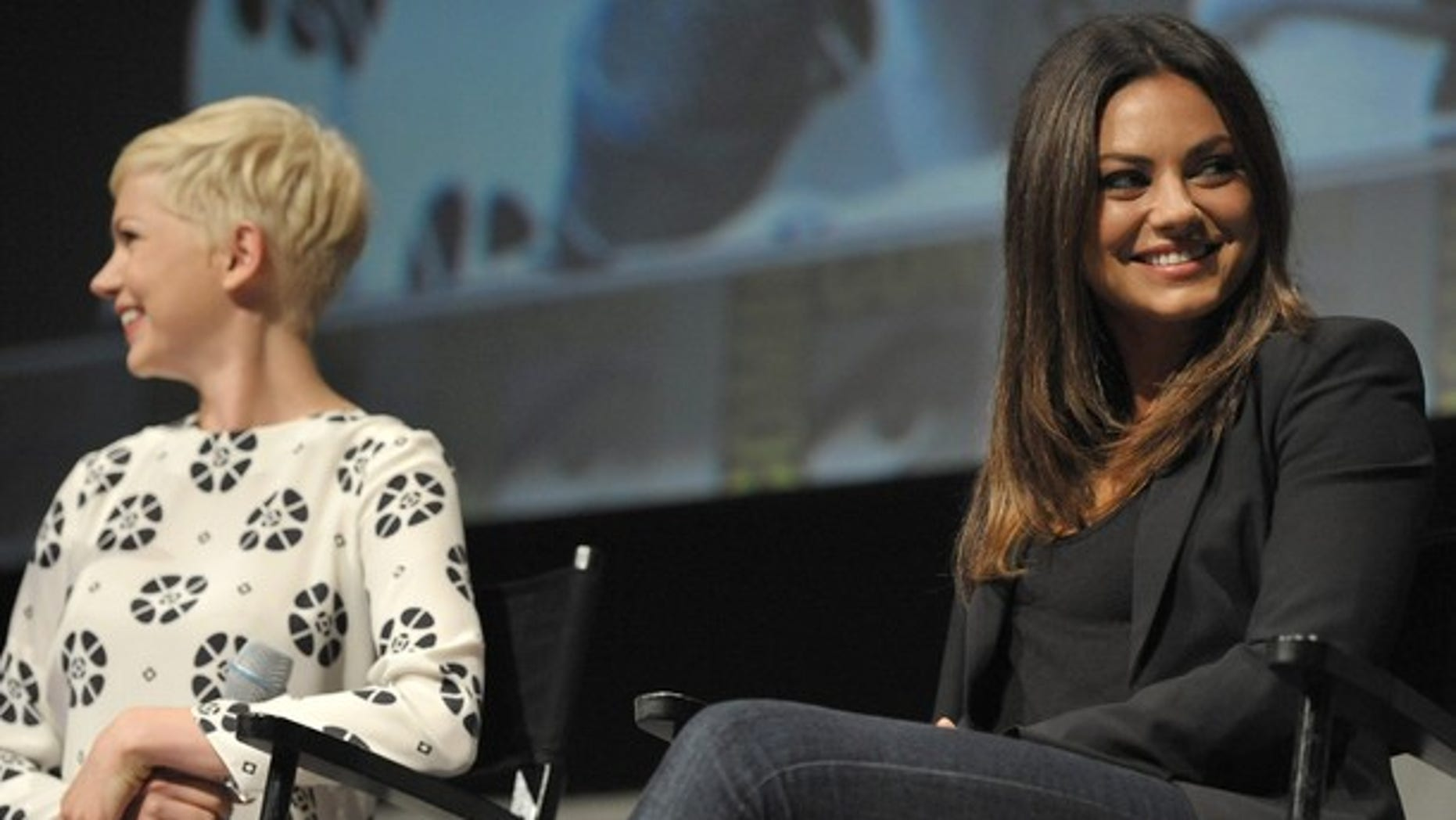 """Michelle Williams and Mila Kunis attend Disney's """"Oz: The Great and Powerful"""" panel at Comic-Con on Thursday, July 12, 2012 in San Diego, Calif. (Photo by John Shearer/Invision/AP)"""