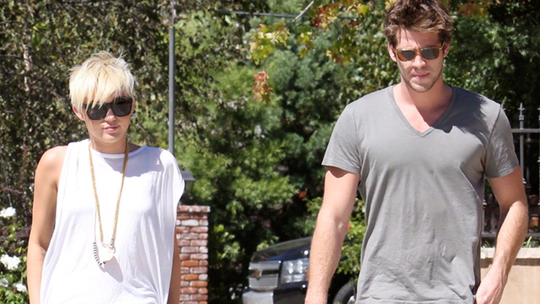 Miley Cyrus and Liam Hemsworth visit a friend in Pasadena. Sunday, September 2, 2012.