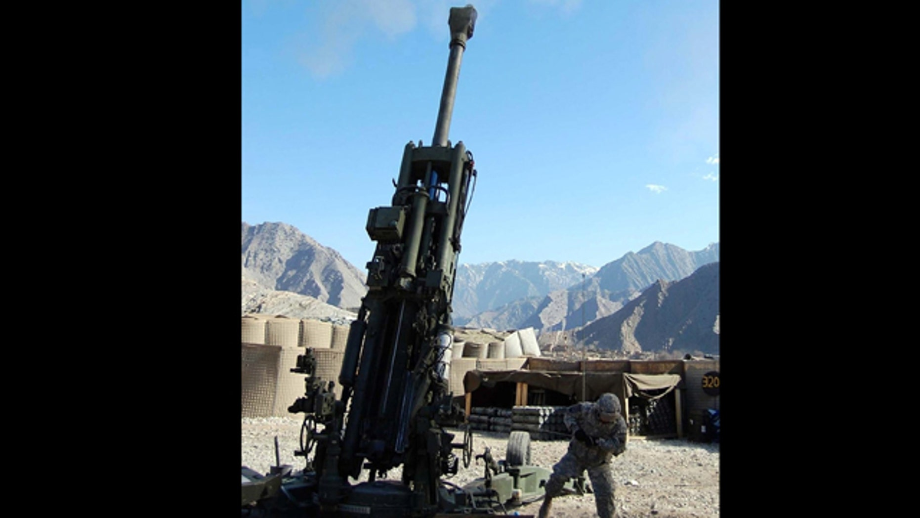 In this Feb. 25, 2008 photo, Pvt. Corey Rodriguez pulls the lanyard on the M-777A2 during the first firing of the Army's new GPS-guided Excalibur artillery round. A software glitch that temporarily left as many as 10,000 military GPS receivers unable to lock on to satellite locator signals showed how dependent the U.S. military has become on the Global Positioning System.