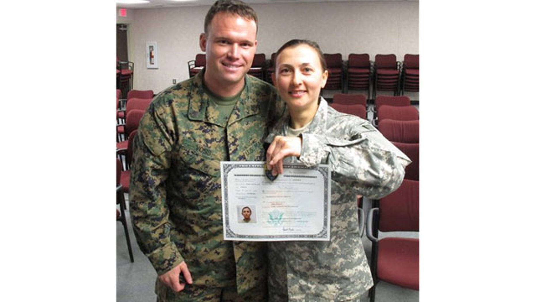 March 16: Army Spc. Rima Rusnac poses with her fiance, Staff Sgt. Ian Voss, after taking the oath to become a U.S. citizen, at Fort Jackson, S.C.