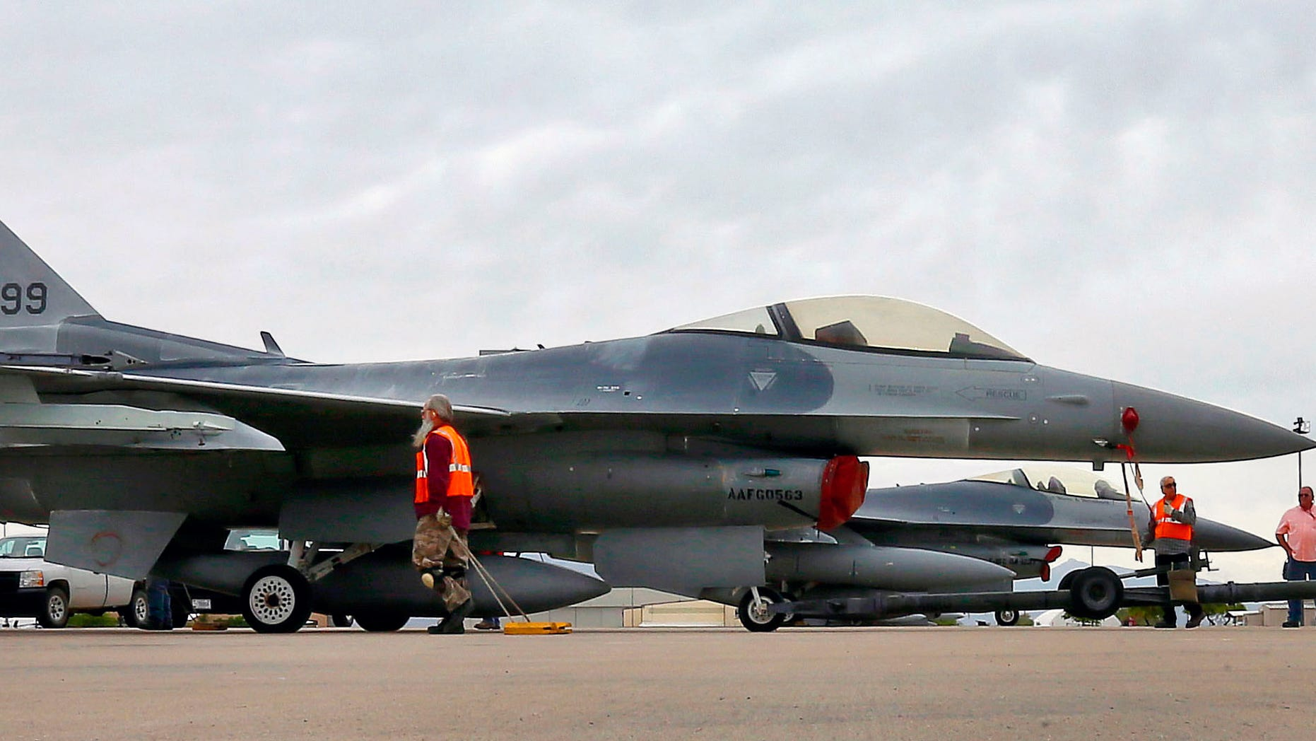 In this May 15, 2015, file photo, a boneyard crew tows an F-16 Fighting Falcon aircraft prior to the preservation process after its arrival at the 309th Aerospace Maintenance and Regeneration Group at Davis-Monthan Air Force Base in Tucson, Ariz. Military officials confirm a single F-16 Fighting Falcon aircraft crashed Wednesday night, June 24, 2015, about 5 miles east of Douglas Municipal Airport.