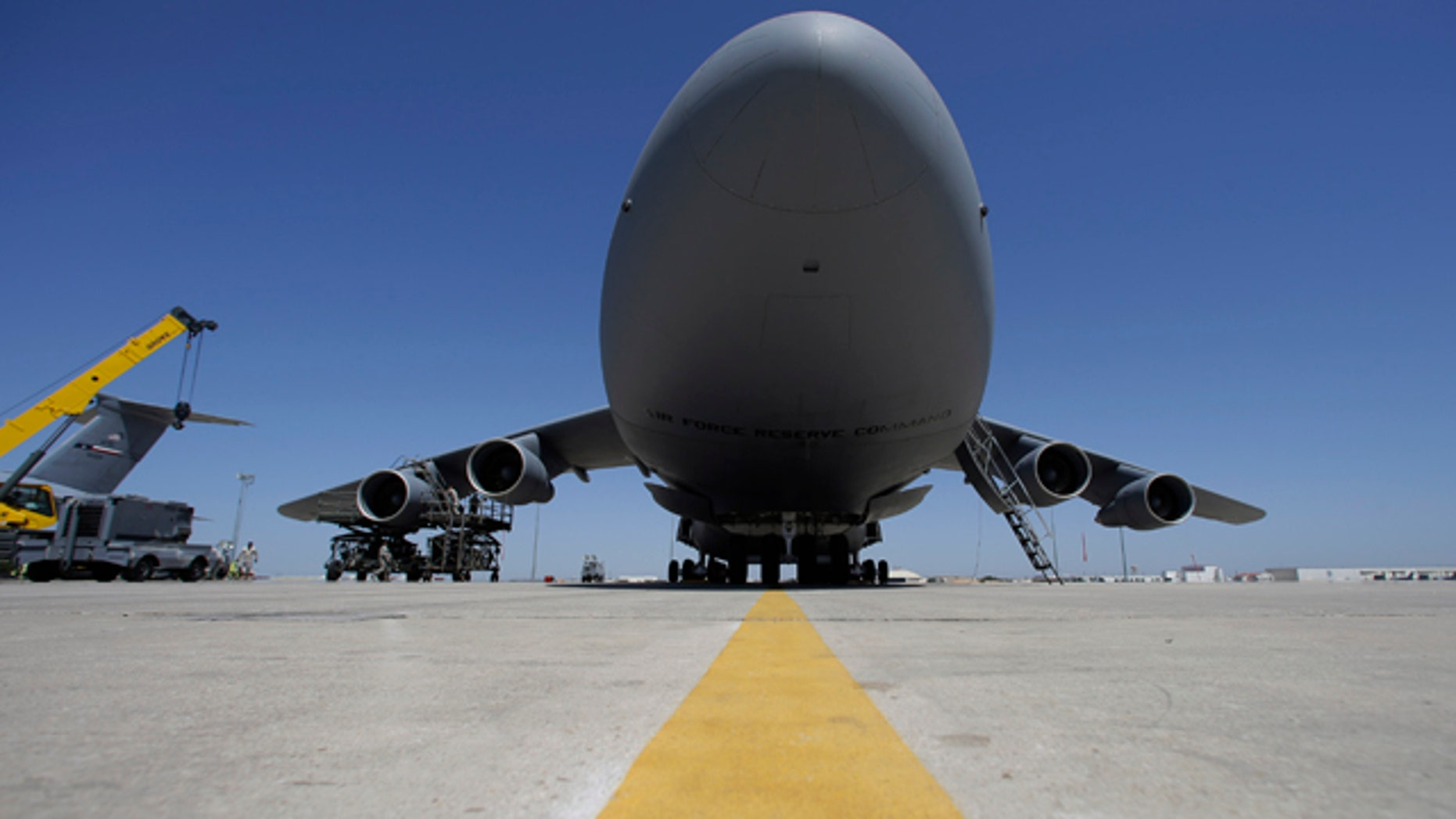 April 11, 2013: Mechanics work on a C-5A military transport aircraft at Lackland Air Force Base in San Antonio.
