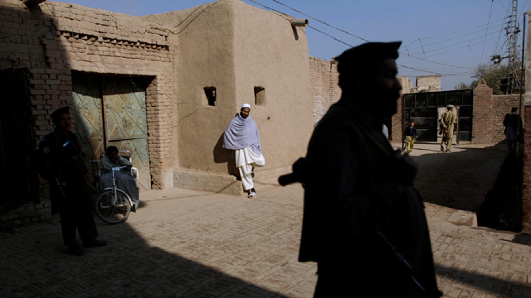 Dec. 9, 2010: Pakistani militants guard their headquarters in Peshawar, Pakistan.