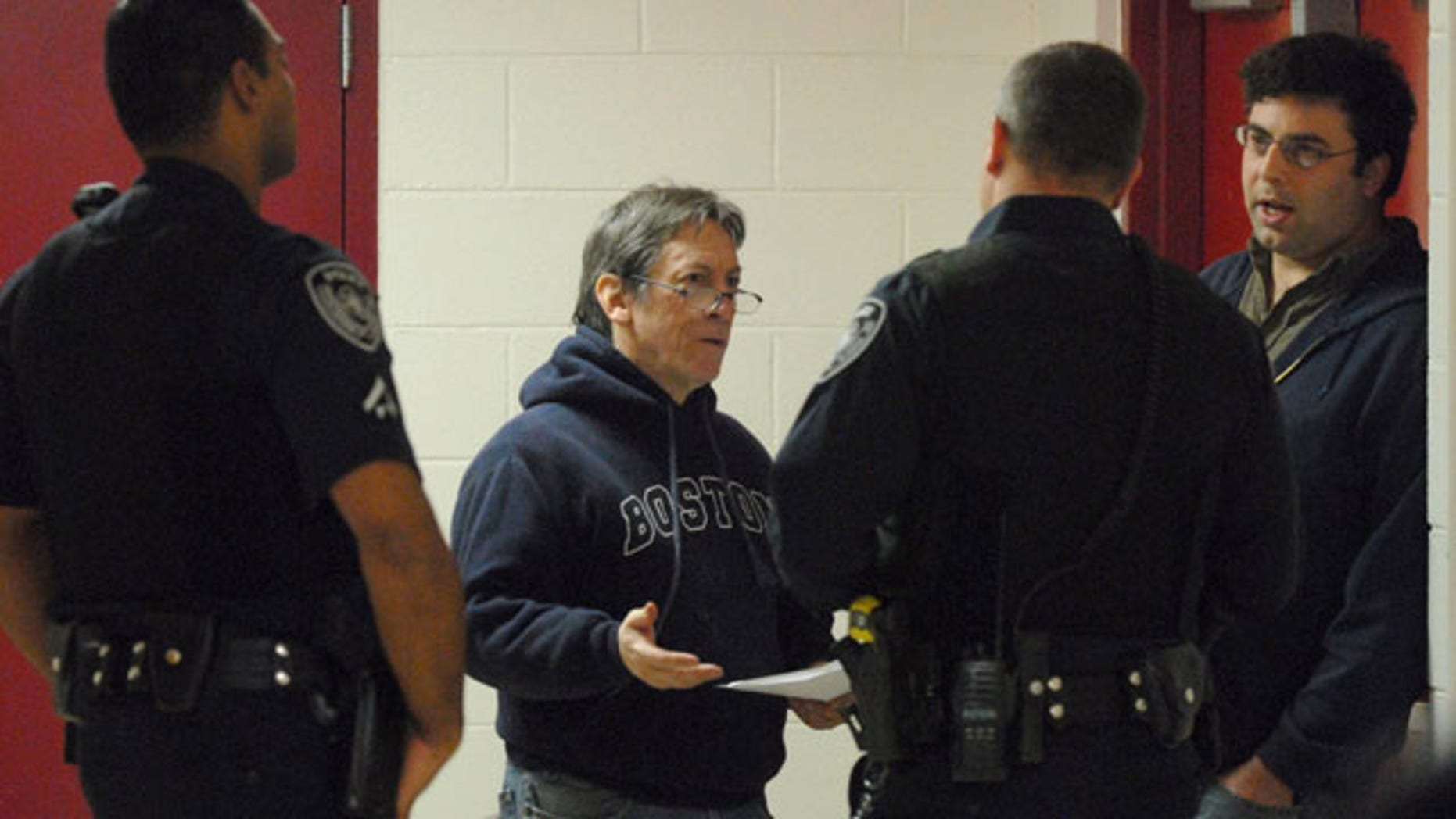 Oct. 17: Attorney John McKay, second from left, and Alaska Dispatch founder and editor Tony Hopfinger, right, talk to Anchorage Police after Hopfinger was detained and handcuffed by a security guard at Alaska Senate candidate Joe Miller's campaign event in Anchorage, Alaska.