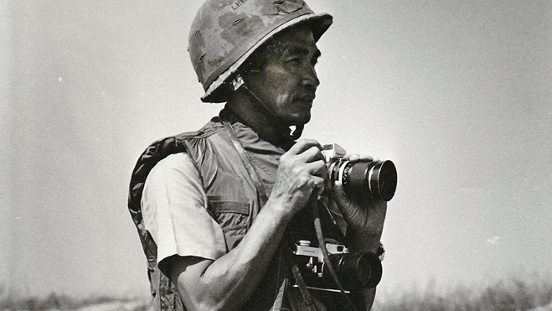FILE 1972: Photo provided by Quynh Thai shows former Vietnamese photographer Le Minh Thai during the battle of An Loc in Vietnam during the war in Vietnam.