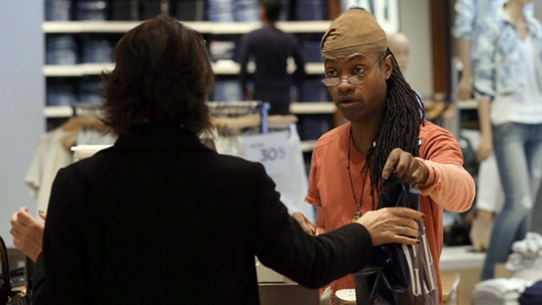 SAN FRANCISCO, CA - FEBRUARY 20:  Gap employee Ni'Jean Gibson helps a customer at a Gap store on February 20, 2014 in San Francisco, California.  Gap Inc. announced that they will raise their minimum wage for U.S. employees to nine dollars in June of 2014 and to $10 by June of 2015.  (Photo by Justin Sullivan/Getty Images)