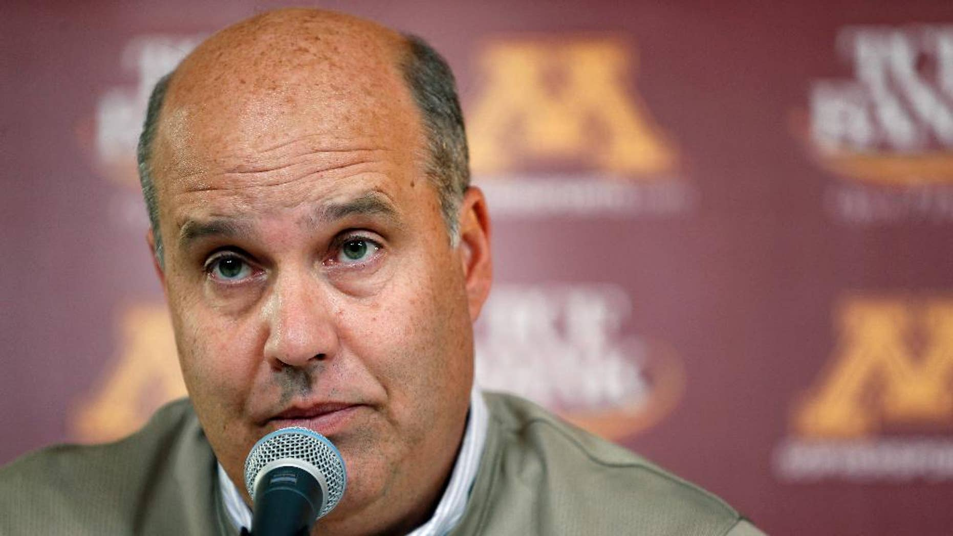FILE - In this Oct. 10, 2013, file photo, Minnesota athletic director Norwood Teague speaks at a news conference in Minneapolis. The University of Minnesota announced Friday, Aug. 7, 2015, that Teague submitted his resignation after three years on the job. (Carlos Gonzalez/Star Tribune via AP, File)