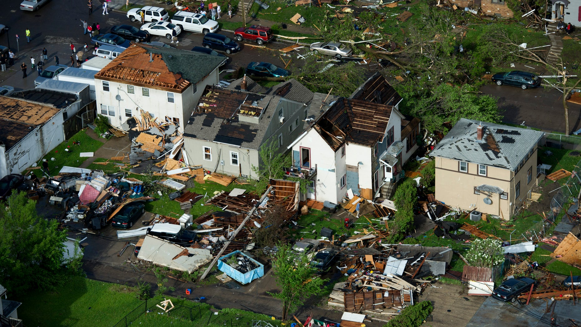 May 22: Damage is shown after a tornado hit northern Minneapolis. At least one tornado hit Minneapolis, damaging scores of homes and toppling hundreds of trees.