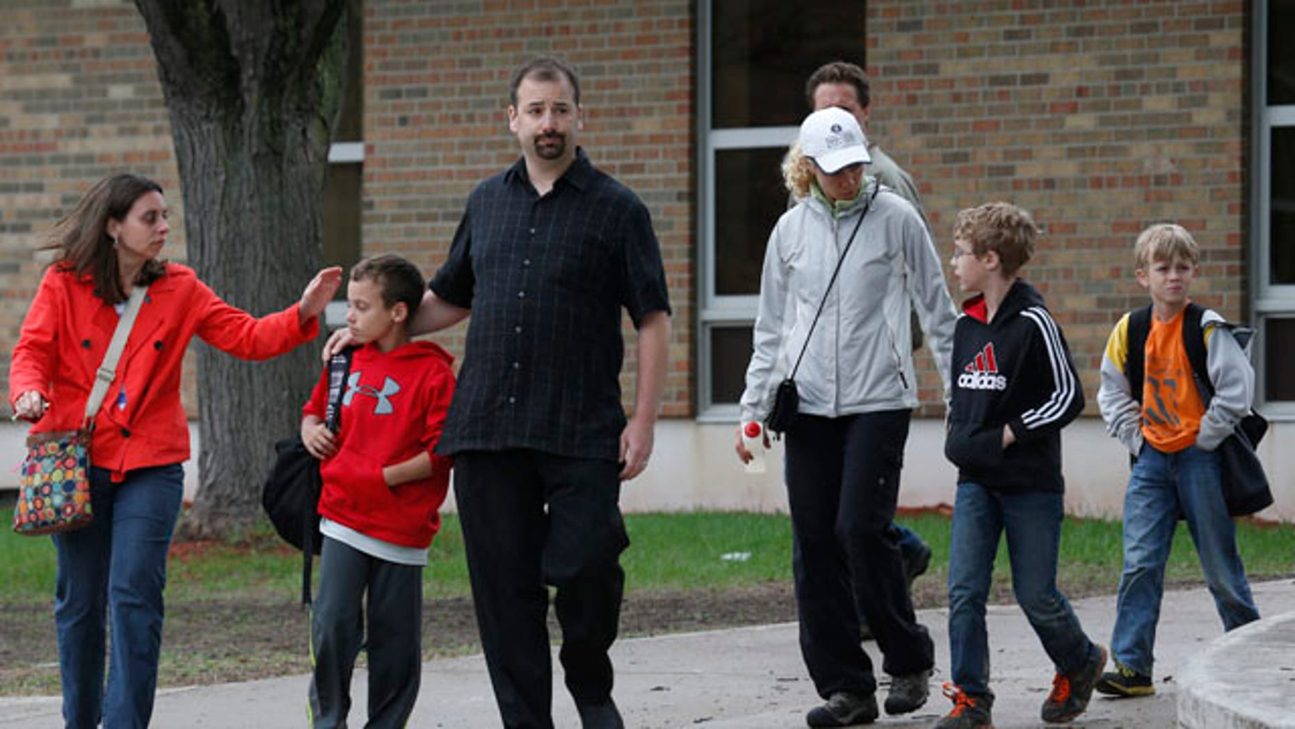May 22, 2013: Parents and their children leave the Peter Hobart Elementary School in St. Louis Park, Minn.