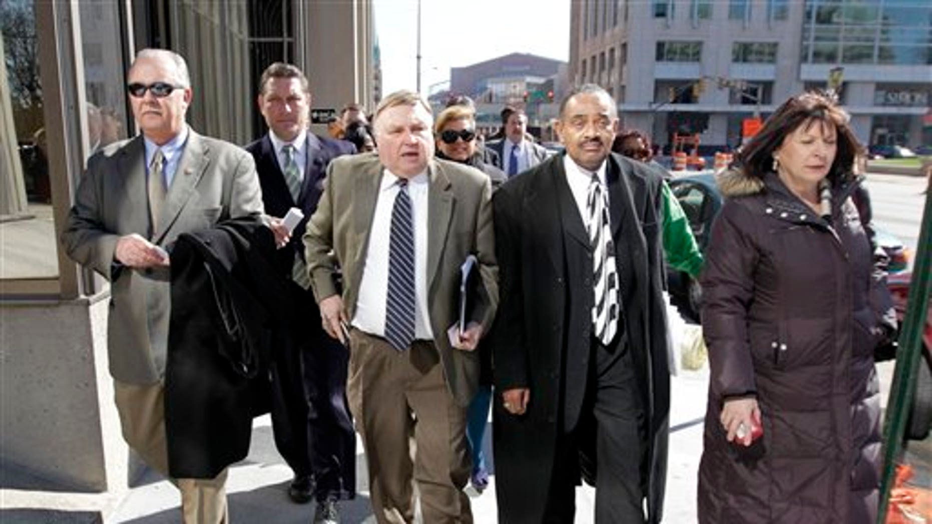 March 28: Minority Leader Pat Bauer walks with fellow Democrats while returning to the Statehouse in Indianapolis.
