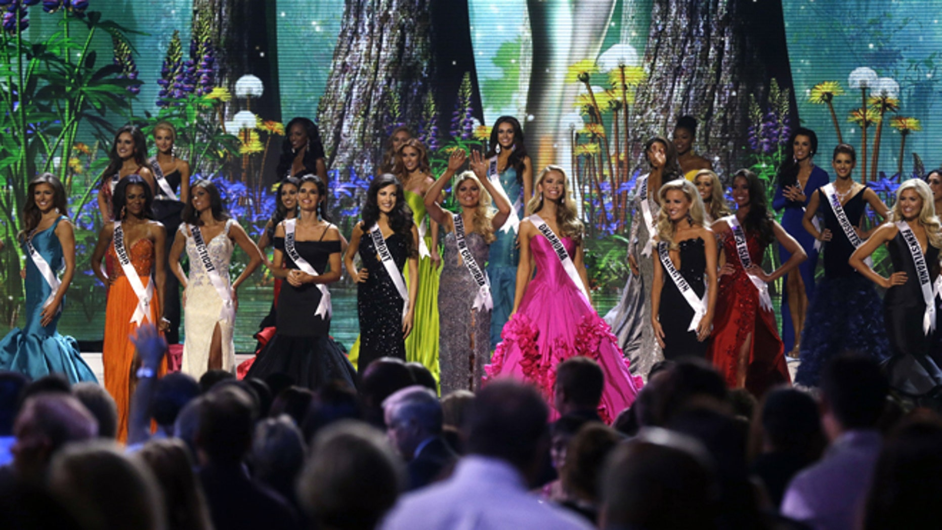 Contestants wave onstage at the conclusion of the preliminary round of the 2015 Miss USA Pageant in Baton Rouge, La., Wednesday, July 8, 2015. (AP Photo/Gerald Herbert)