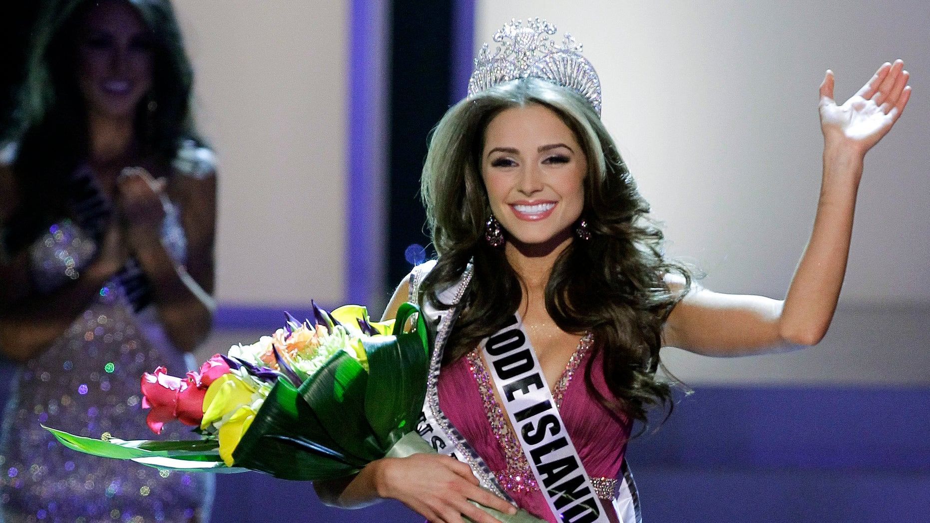 June 3, 2012: Miss Rhode Island Olivia Culpo waves to the audience after being crowned Miss USA during the 2012 Miss USA pageant.