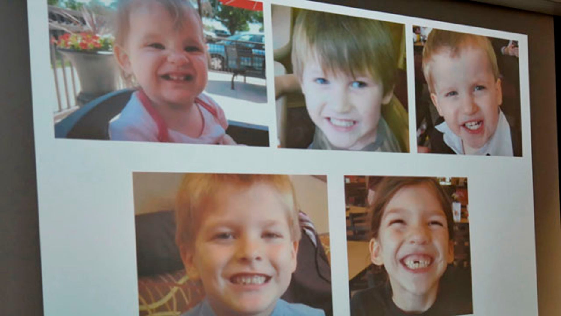 September 10, 2014: Photos of Timothy Ray Jones Jr.'s children are on display during a news conference at the Lexington County Sheriff's Dept Training Center in Lexington, S.C. Jones Jr., 32, is charged with murder in the deaths of his five children after he led authorities to a secluded clearing in Alabama, where their bodies were found wrapped in garbage bags, a sheriff said Wednesday.  (AP Photo/ Richard Shiro)