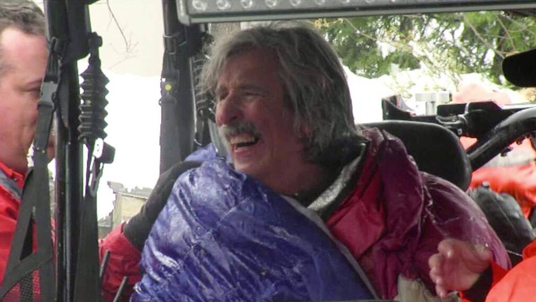 This image from video provided by KTXL Fox 40 Sacramento, shows trail runner Robert Root after being rescued Tuesday, April 1, 2014, near Foresthill, Calif., in Placer County. Root was found alive in snowy conditions, two days after he went missing near a trail in a mountainous region of Northern California, authorities said. Root, 55, of Modesto, Calif., was wearing only a light running shirt, shorts and running shoes when he was discovered by rescuers on the Western States trail. (AP Photo/KTXL Fox 40 Sacramento)