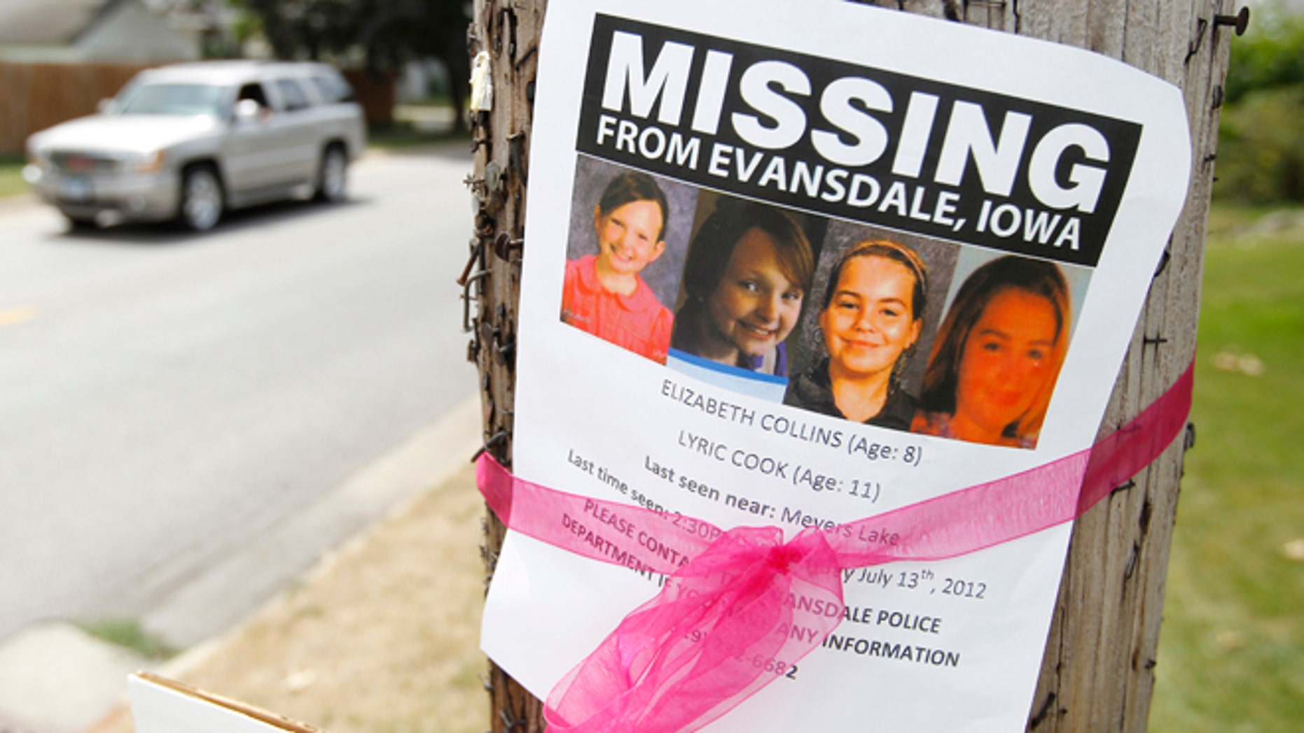 July 19: A sign is posted in Waterloo, Iowa, for the missing cousins Lyric Cook-Morrissey, 10, and Elizabeth Collins, 8.