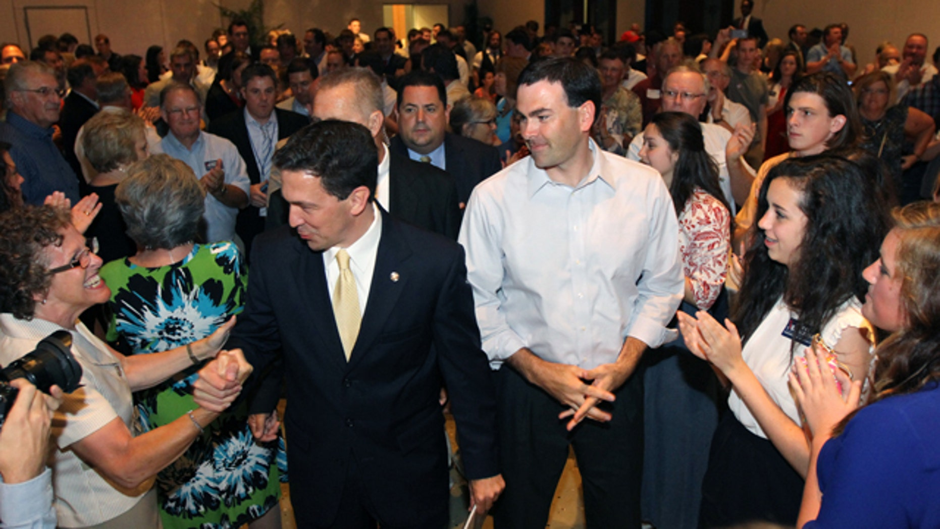 June 3, 2014: Chris McDaniel greets supporters as he heads to the podium to speak about his close race with incumbent U.S. Senator Thad Cochran during McDaniel's election night party at the Lake Terrace Convention Center in Hattiesburg, Miss.  (AP Photo/George Clark)