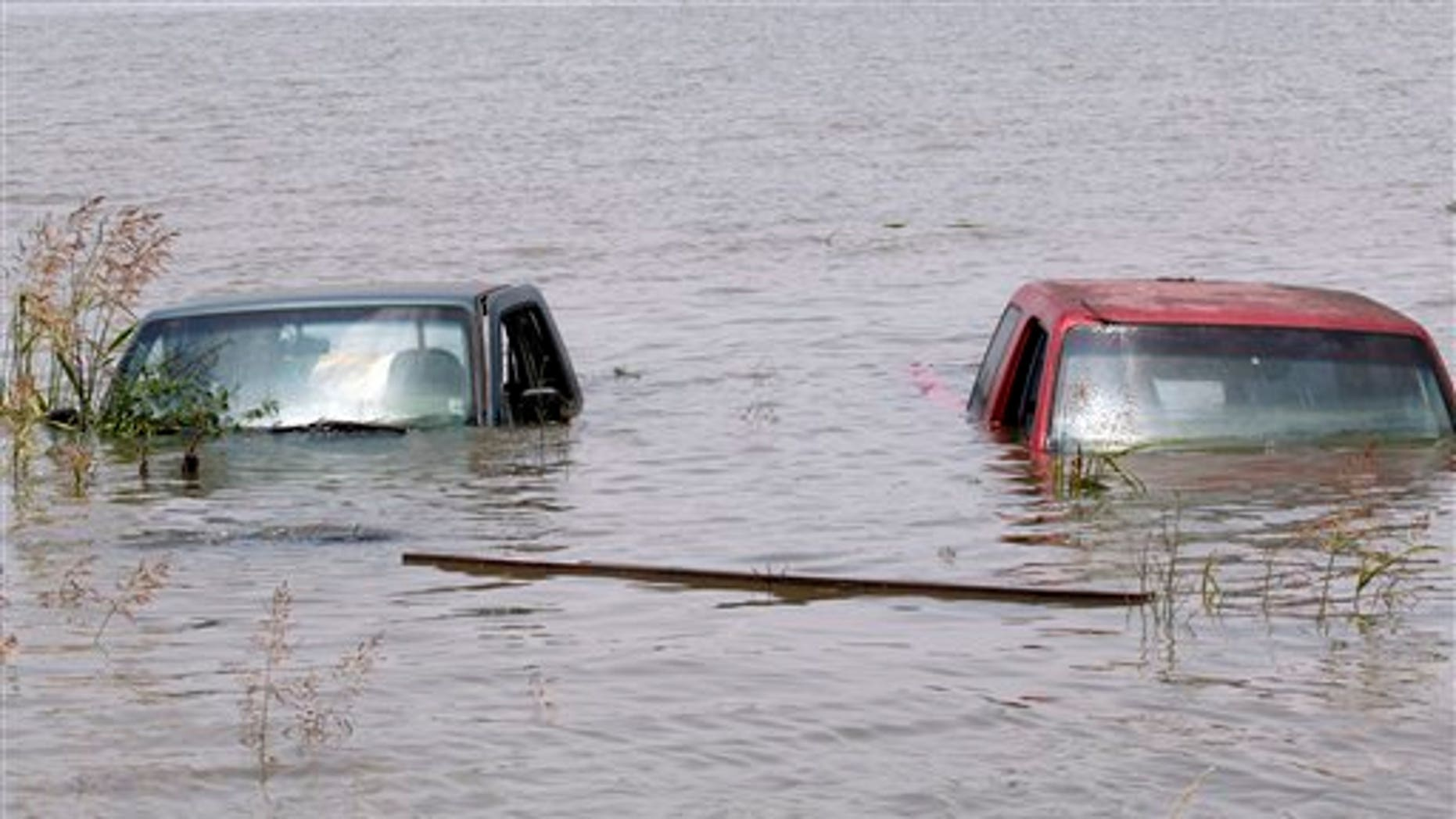 May 23: Vehicles are submerged in flood waters at a parking lot on the outskirts of Yazoo City, Miss.