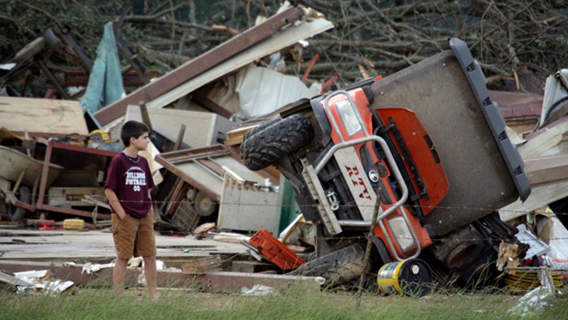 April 27: A young resident surveys the damage to a home near Bond, Miss.