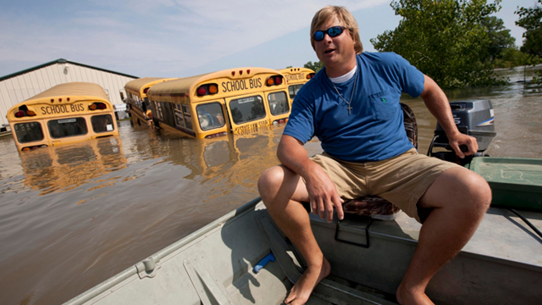May 21: Chris Lynn checks his fathers property which is still surrounded by floodwaters from the Mississippi River in Vicksburg, Miss.