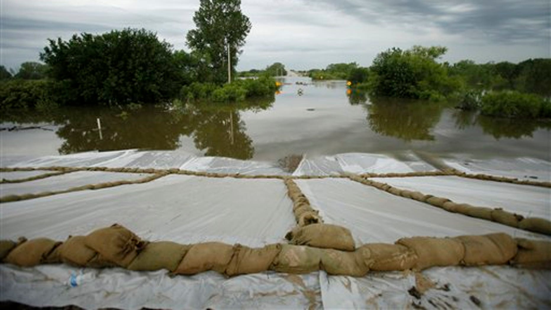 June 16: Floodwaters from the Missouri River covering Highway 333 outside of town approach a levee in Hamburg, Iowa.