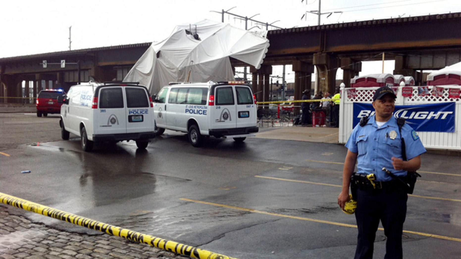 April 28, 2012: Officials respond to the scene where a tent blew over after high winds crossed the area in St. Louis.