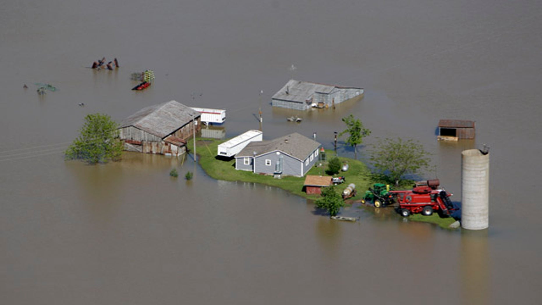 May 3: A farm is seen surrounded by floodwater near New Madrid, Mo.