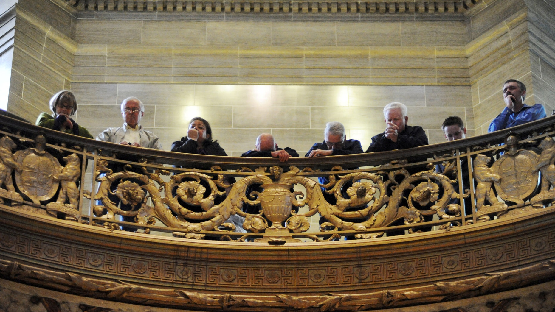 """March 29, 2010: Participants in the """"Show Me Your Glory Lord!"""" service pray in the State Capitol in Jefferson City, Mo."""