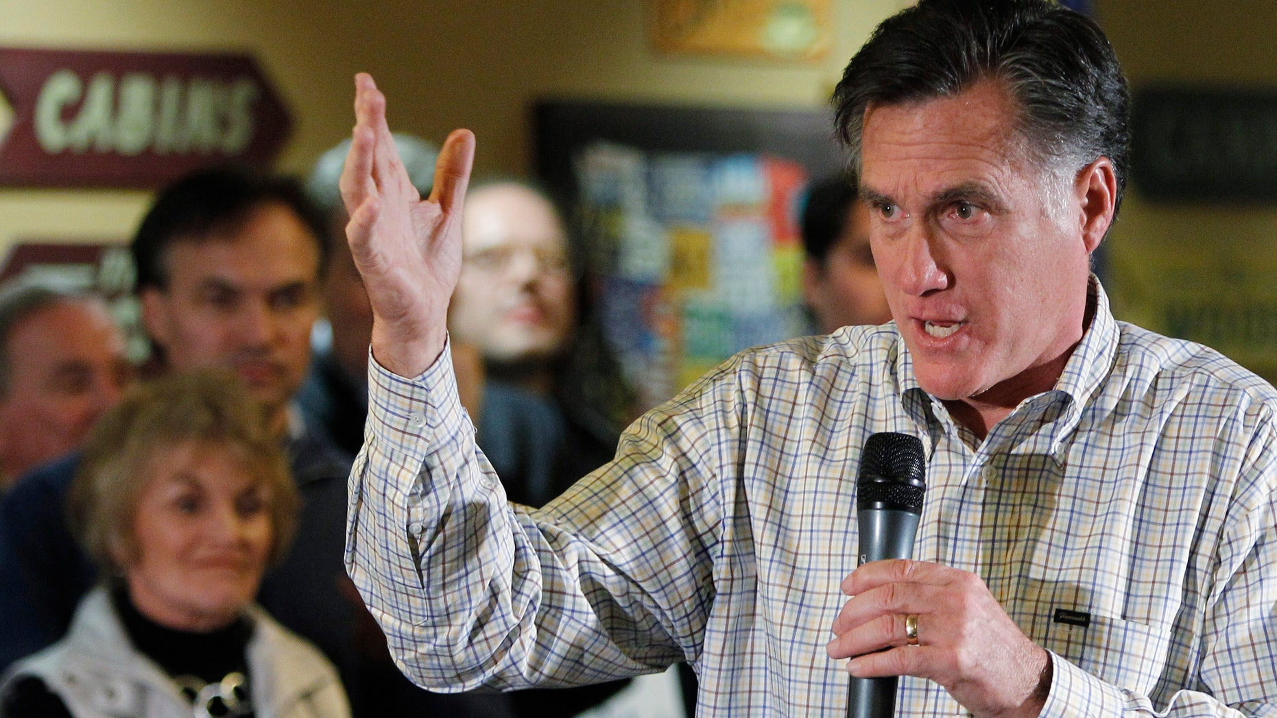 Republican presidential candidate, former Massachusetts Gov. Mitt Romney speaks during a town hall meeting, Saturday, Dec. 31, 2011, in Sioux City, Iowa. (AP Photo/Eric Gay)