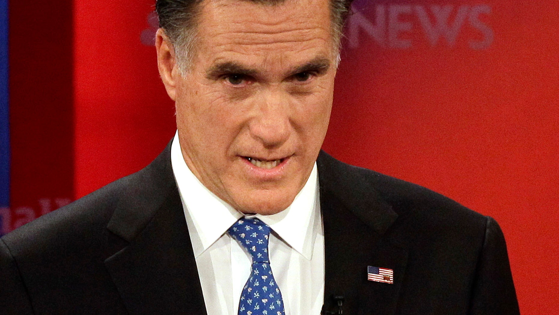 Republican presidential candidate former Massachusetts Gov. Mitt Romney gestures during a Republican presidential debate Monday Jan. 23, 2012, at the University of South Florida in Tampa, Fla. (AP Photo/Paul Sancya)