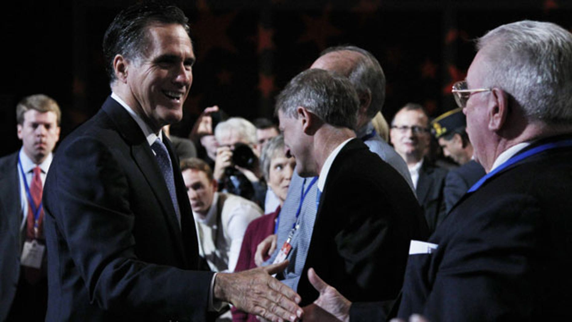 October 8: Republican presidential candidate former Governor Mitt Romney, left, greets the crowd after delivering his remarks at the Values Voter Summit in Washington.
