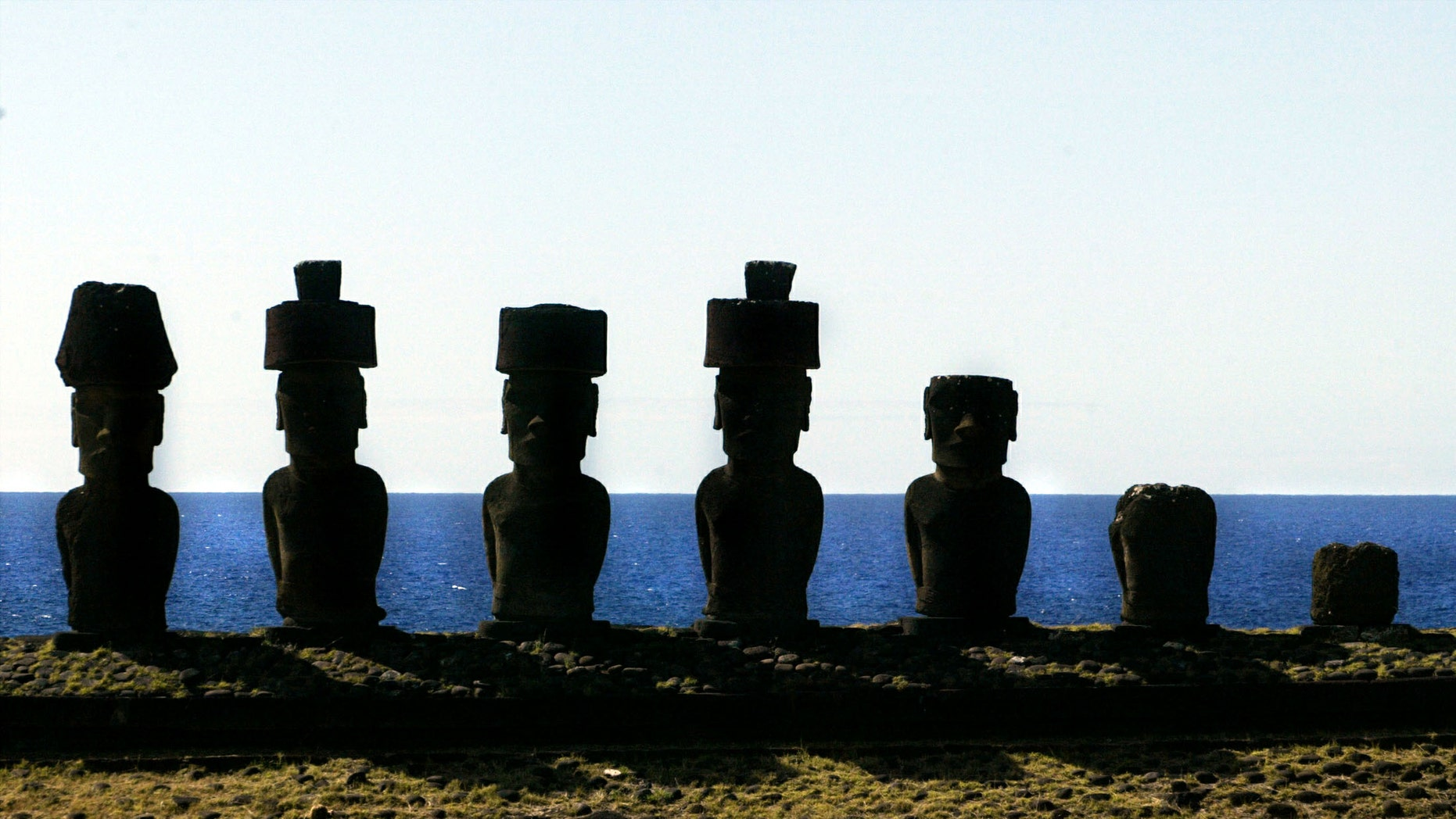 """A view of """"Moai"""" statues in the Anakena beach on Easter Island, 2,486 miles west of Santiago, in this photo taken October 29, 2003."""