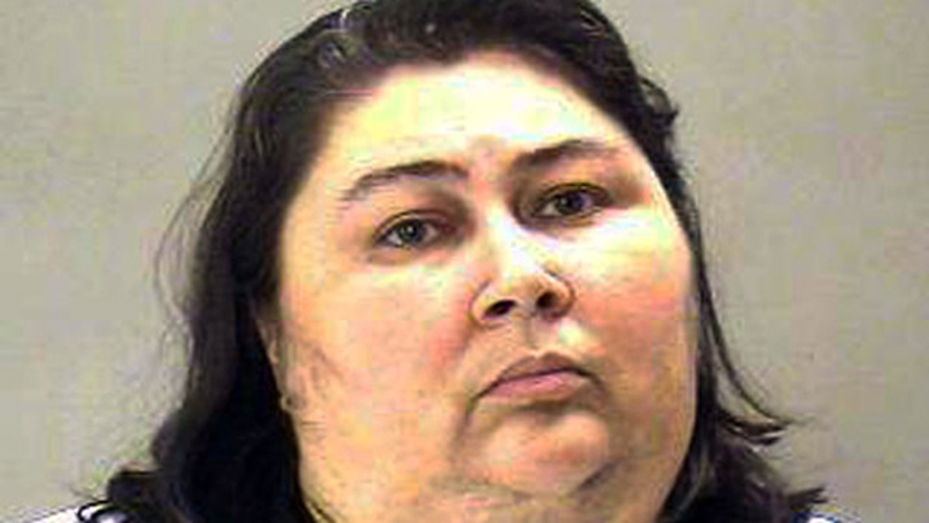 This undated booking photo provided by the Dallas County Sheriff Department shows Tina Marie Alberson, 44.