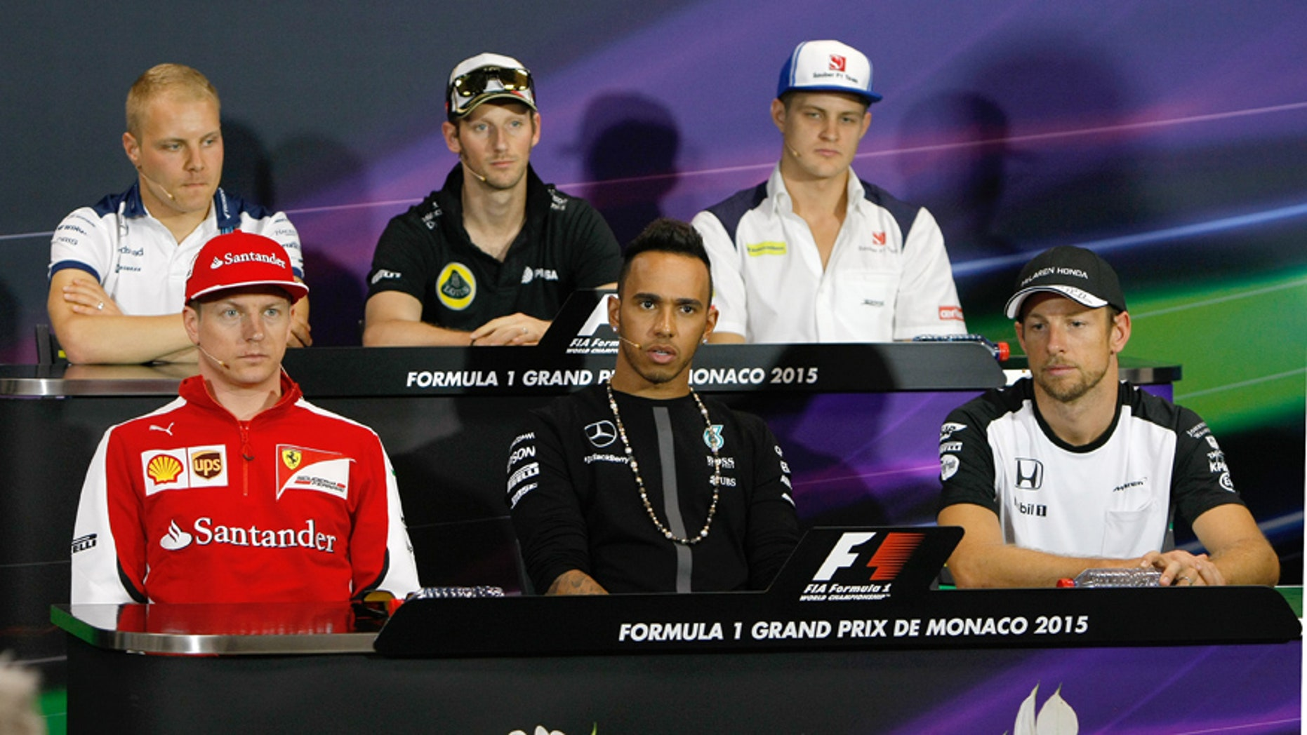 Ferrari driver Kimi Raikkonen of Finland, front left, Mercedes driver Lewis Hamilton of Britain, front center, McLaren driver Jenson Button of Britain, front right, Sauber driver Marcus Ericsson of Sweden, top left, Lotus driver Romain Grosjean of France, top center, and Williams driver Valtteri Bottas of Finland attend a press conference prior to the Formula One Grand Prix at the Monaco racetrack, in Monaco, Wednesday May 20, 2015. The Formula One race will be held on Sunday. (AP Photo/Claude Paris)