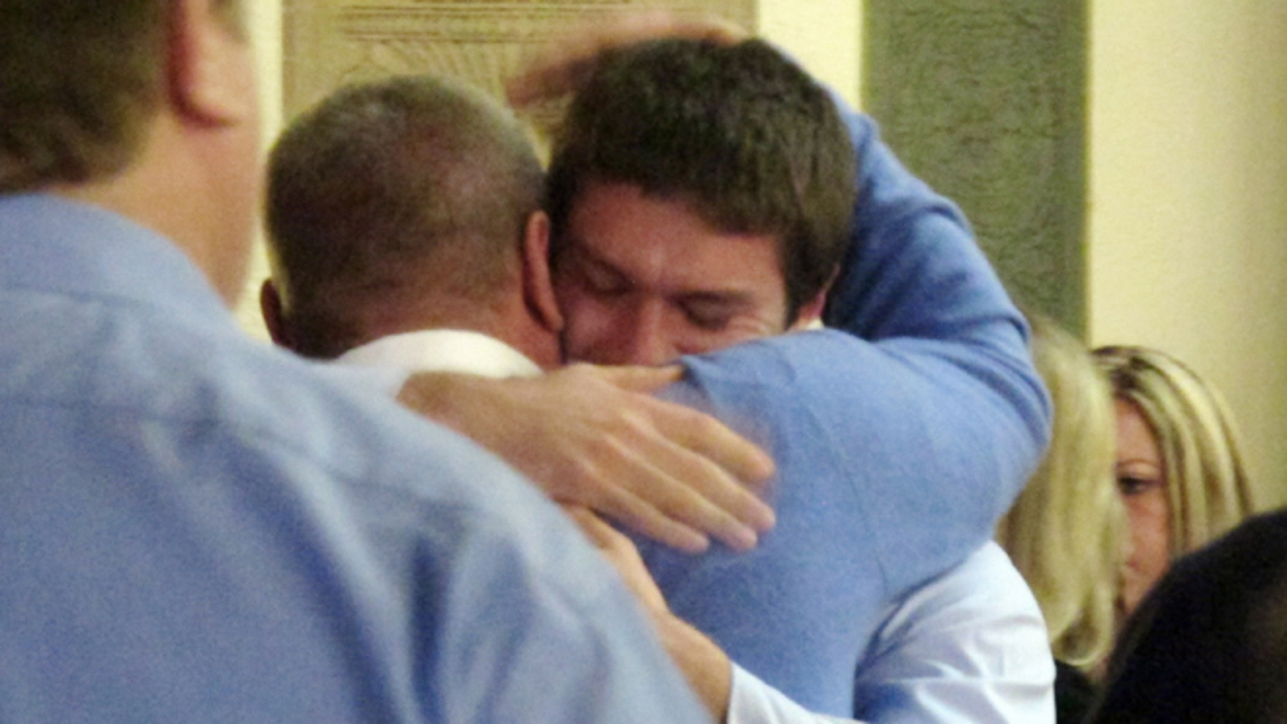 March 1: Former University of Montana quarterback, Jordan Johnson, facing camera, is hugged by a supporter after being acquitted of rape charges during his trial.