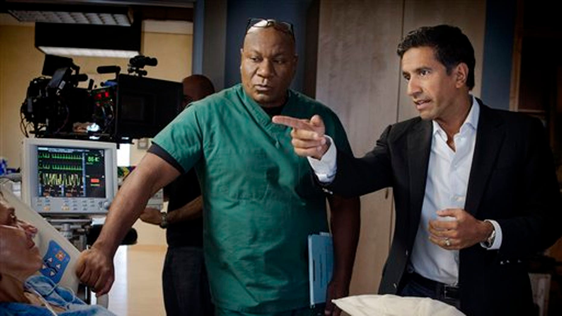"""This undated image released by TNT shows Ving Rhames portraying Dr. Jorge Villanueva, left, and Executive Producer Dr. Sanjay Gupta on the set of """"Monday Mornings"""" a medical drama premiering Monday, Feb. 4, 2013 at 10 p.m. EST on TNT."""