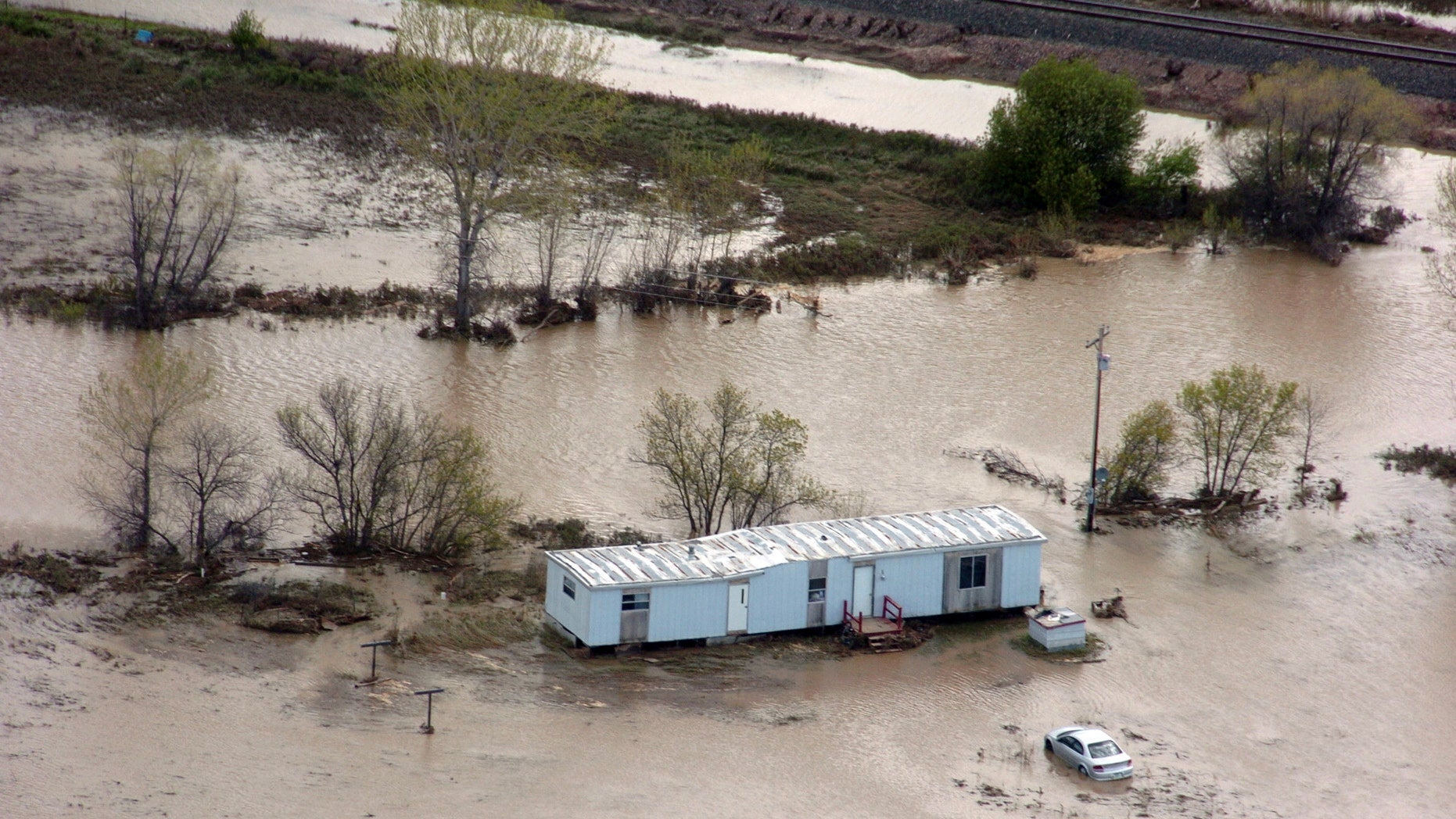 May 27: A flooded mobile home near Crow Agency, Mont. Recent flooding displaced hundreds of residents of the Crow Indian Reservation and damaged an estimated 200 homes. (AP)