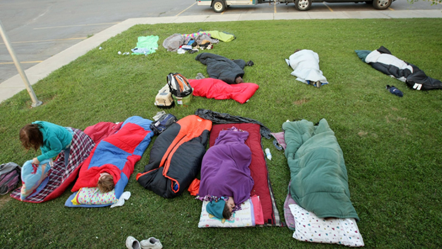 Aug. 3, 2012: A church group from Indiana sleeps outside the Saint Labre Mission after evacuating a bible school at the Morning Star Baptist Church, fleeing the fire in Lame Deer, Mont.