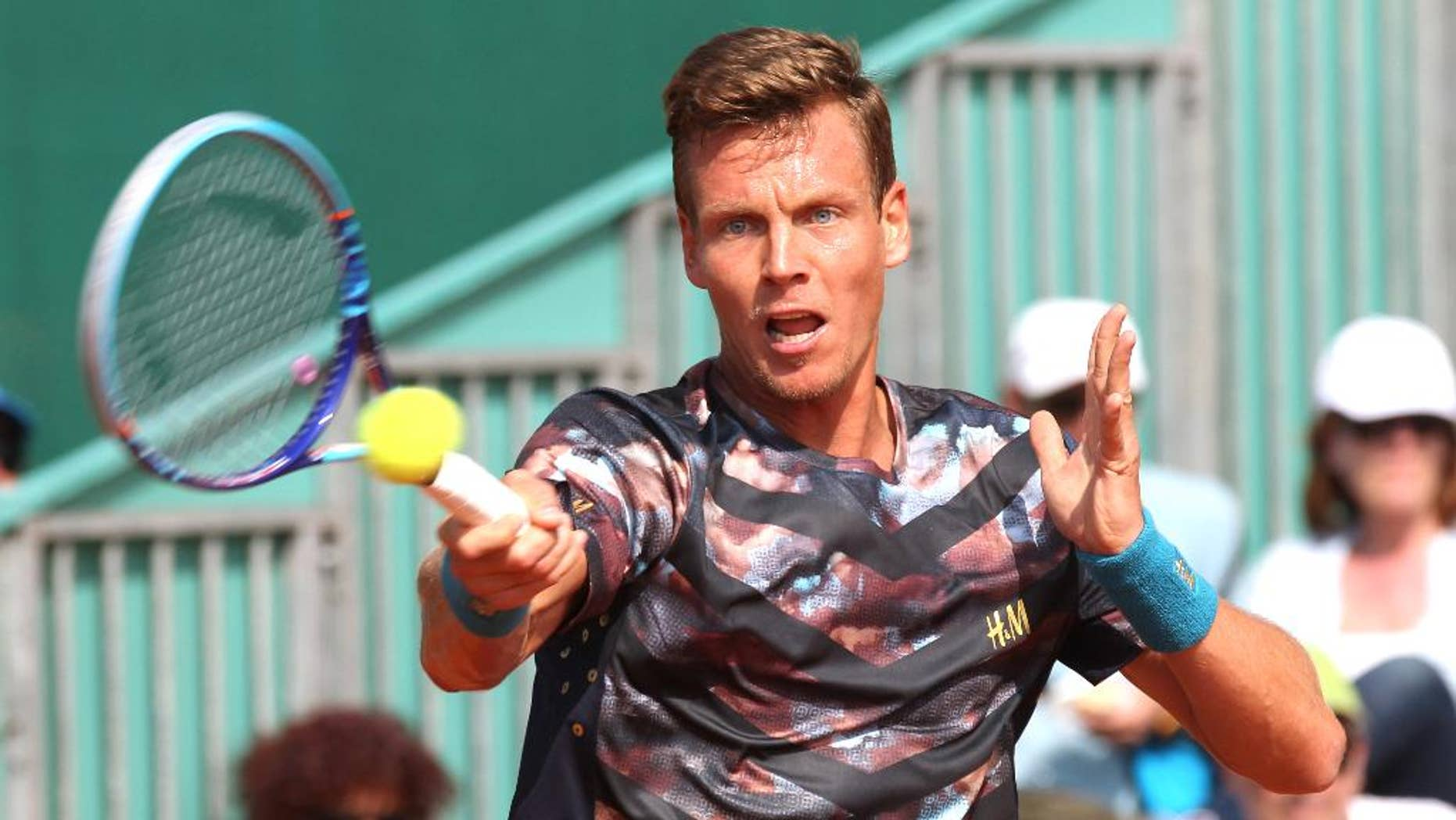 Thomas Berdych of Czech Republic plays a return to Ukrainian Sergiy Stakhovsky during their match of the Monte Carlo Tennis Masters tournament in Monaco, Wednesday, April 15, 2015. (AP Photo/Lionel Cironneau)