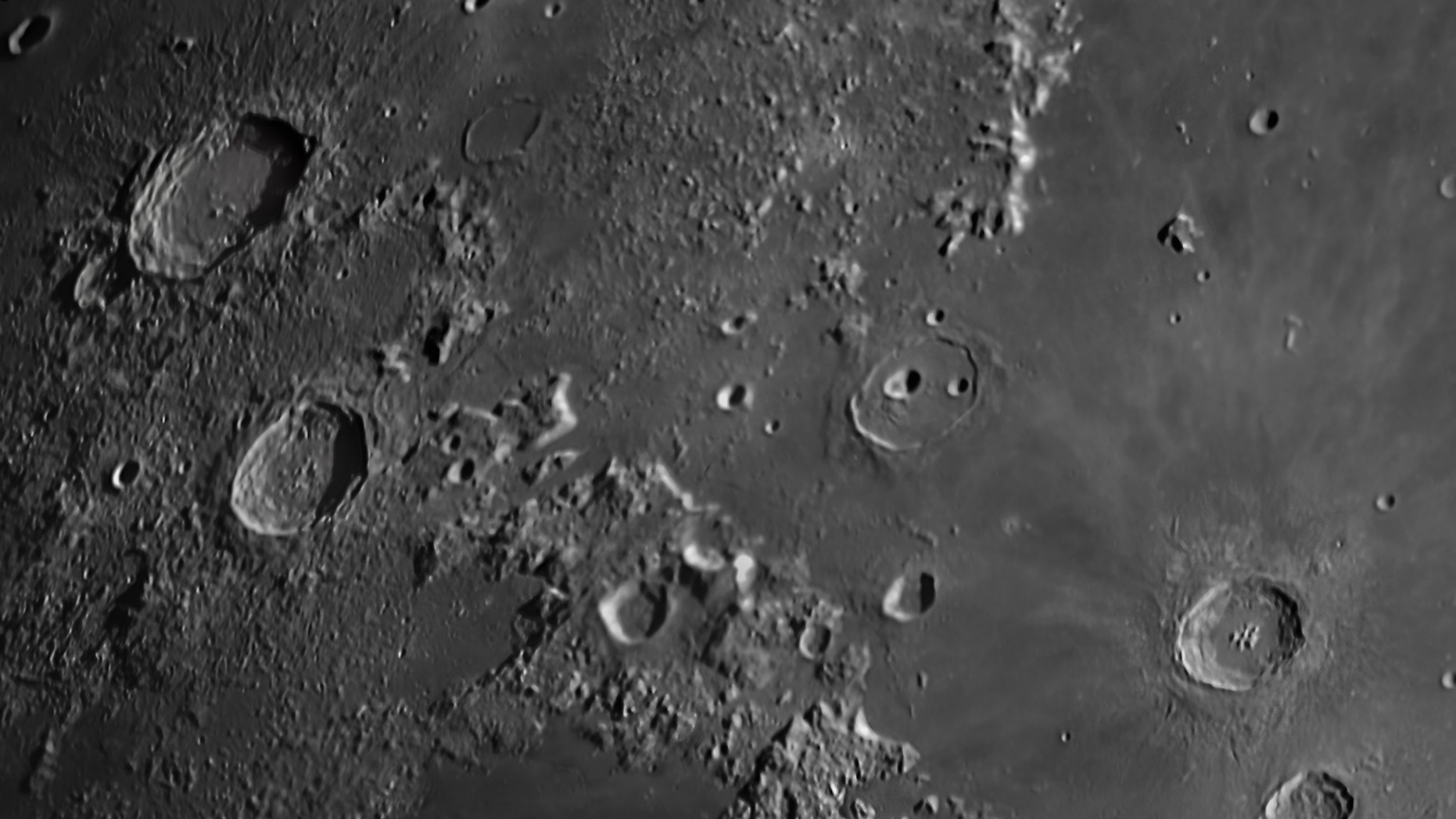A lunar landscape scene captured from the Cumeada Observatory in Portugal's Dark Sky Alqueva Reserve shows the impact craters of Aristoteles, Eudoxus, Aristillus and Autolycus.