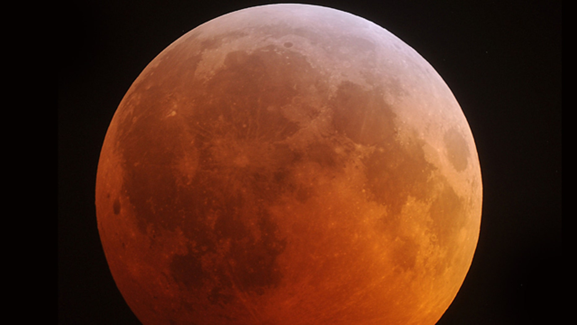Dec. 21: The eclipsed moon glows in the predawn sky in this view from Stedman, N.C.