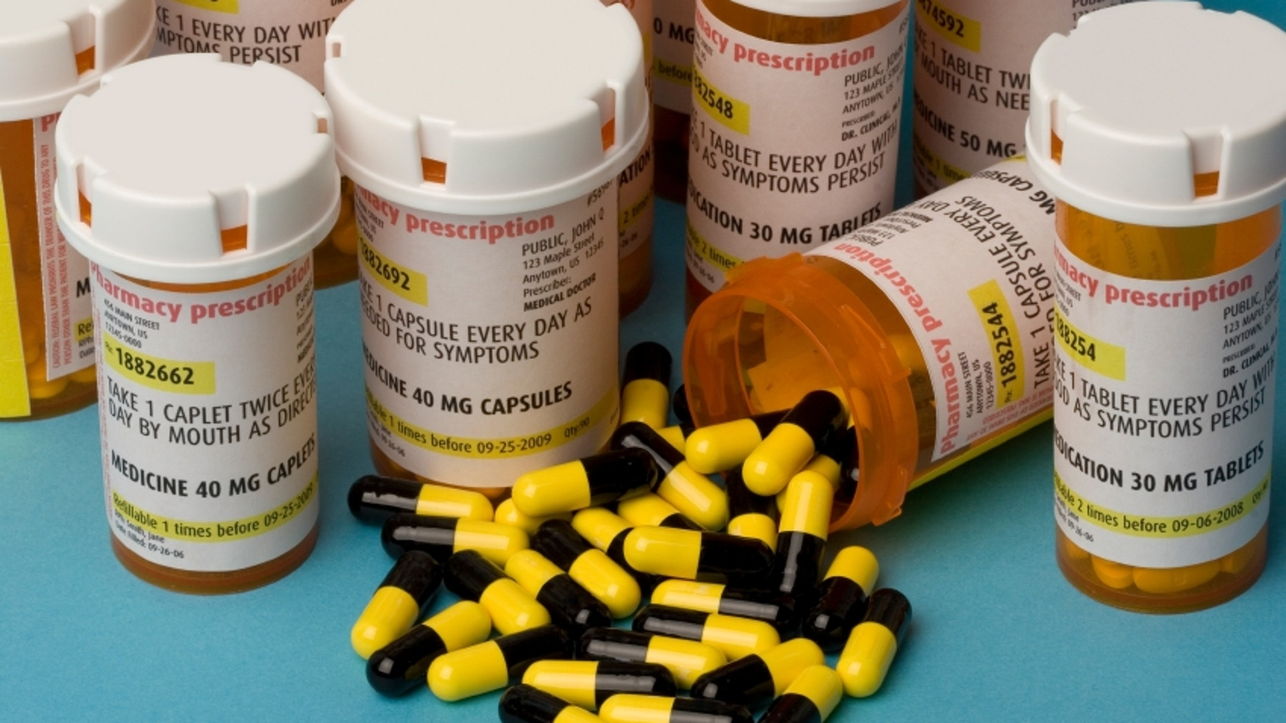 Bottles of prescription medication. Labels are fake, with false information.