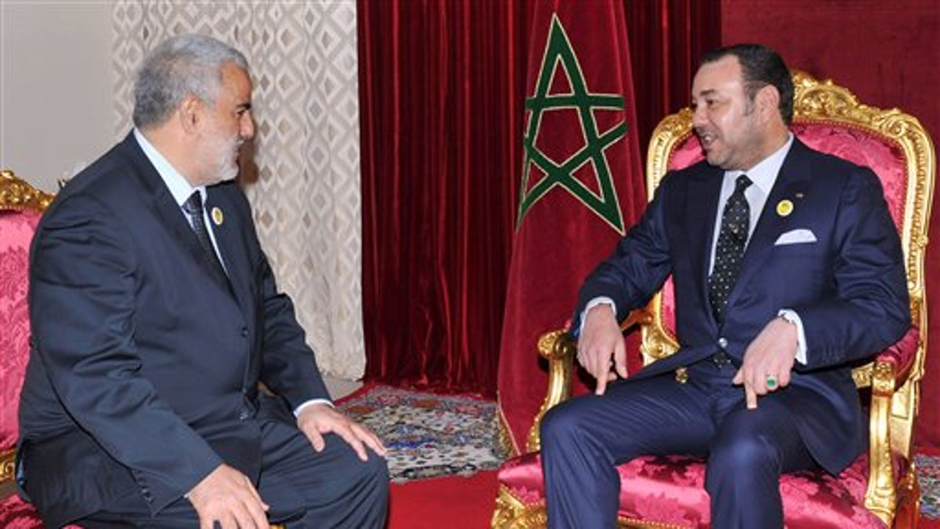 November 29: King Mohammed VI, right, receives Abdelilah Benkirane, the secretary general of the Justice and Development Party, to appoint him as the head of the country's new government, in the mountain town of Midelt, Morocco.